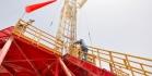 A worker climbs a drilling rig at the Rumaila oil field. (BEN VAN HEUVELEN/Iraq Oil Report)
