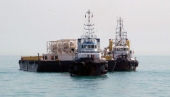 Tugboats position a single point mooring (SPM) buoy in the Basra Gulf in January 2012 as Iraq expands its export capacity. (ALI ABU IRAQ/Iraq Oil Report)