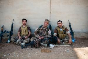 Kurdish soldiers guarding Mount Sinjar pose with their weapons. (ADAM MIRANI)