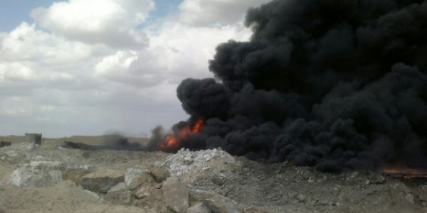 As wellheads burn, Iraqi forces retake Qayarah air base